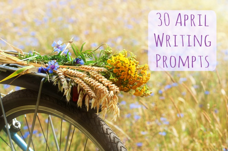 A boquet of summer wildflowers and wheat on a bike and summer field background